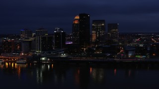 DX0001_003113 - 5.7K stock footage aerial video approach the city's skyline at twilight from the Ohio River, Downtown Louisville, Kentucky