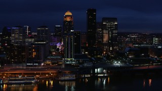 DX0001_003118 - 5.7K stock footage aerial video slowly fly away from the city skyline at twilight, reveal the river, Downtown Louisville, Kentucky