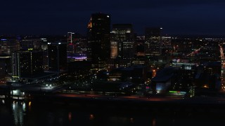 DX0001_003121 - 5.7K stock footage aerial video slowly flying past the city skyline at twilight, seen from the river, Downtown Louisville, Kentucky