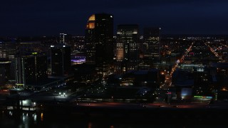 DX0001_003122 - 5.7K stock footage aerial video flying by the city's skyline at twilight, Downtown Louisville, Kentucky
