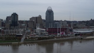 DX0001_003127 - 5.7K stock footage aerial video a view of the baseball stadium and skyscraper during ascent over river, Downtown Cincinnati, Ohio