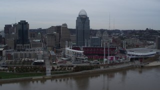 DX0001_003128 - 5.7K stock footage aerial video descend toward river with view of the baseball stadium and skyscraper, Downtown Cincinnati, Ohio
