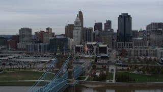 DX0001_003131 - 5.7K stock footage aerial video approach city skyline from bridge over the Ohio River, Downtown Cincinnati, Ohio