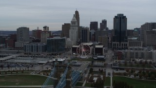 DX0001_003135 - 5.7K stock footage aerial video reverse view of city's skyline, reveal the bridge and river, Downtown Cincinnati, Ohio