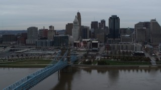 DX0001_003140 - 5.7K stock footage aerial video of the Roebling Bridge and city skyline seen from the Ohio River, Downtown Cincinnati, Ohio