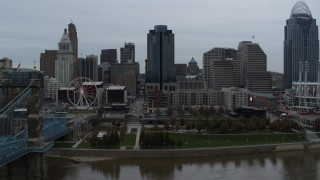 DX0001_003143 - 5.7K stock footage aerial video fly over Ohio River to approach tall skyscraper, Downtown Cincinnati, Ohio