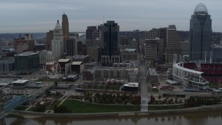 DX0001_003144 - 5.7K stock footage aerial video reverse view of tall skyscraper and skyline, reveal Ohio River, Downtown Cincinnati, Ohio
