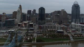 DX0001_003146 - 5.7K stock footage aerial video slow approach to city skyline and Scripps Center from the Ohio River, Downtown Cincinnati, Ohio