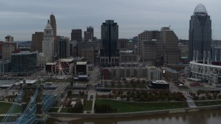 DX0001_003148 - 5.7K stock footage aerial video ascend and fly away from city skyline, reveal the river, Downtown Cincinnati, Ohio
