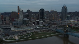 DX0001_003153 - 5.7K stock footage aerial video of the city skyline seen from the Roebling Bridge over the river at sunset, Downtown Cincinnati, Ohio