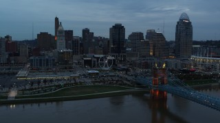 DX0001_003159 - 5.7K stock footage aerial video passing the city skyline at sunset, seen from Ohio River, Downtown Cincinnati, Ohio