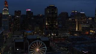 DX0001_003182 - 5.7K stock footage aerial video of Scripps Center skyscraper at twilight, Downtown Cincinnati, Ohio
