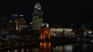 DX0001_003199 - 5.7K stock footage aerial video orbit Roebling Bridge at night with city skyline in background, Downtown Cincinnati, Ohio