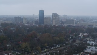 DX0001_003206 - 5.7K stock footage aerial video flying by the city skyline seen from residential neighborhoods, Downtown Lexington, Kentucky