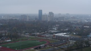 DX0001_003207 - 5.7K stock footage aerial video reverse view of the city skyline seen from residential neighborhoods, Downtown Lexington, Kentucky