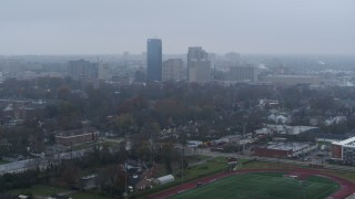 DX0001_003208 - 5.7K stock footage aerial video slowly flying by the city skyline seen from residential neighborhoods, Downtown Lexington, Kentucky