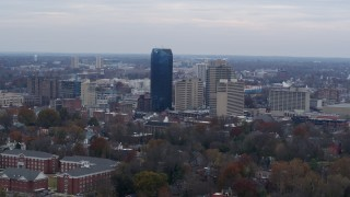 DX0001_003213 - 5.7K stock footage aerial video slowly passing the city's skyline, seen from tree-lined neighborhoods, Downtown Lexington, Kentucky