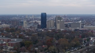 DX0001_003214 - 5.7K stock footage aerial video focus on the city's skyline from tree-lined neighborhoods, Downtown Lexington, Kentucky