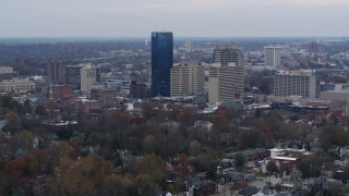DX0001_003215 - 5.7K stock footage aerial video flyby and approach the city's skyline from tree-lined neighborhoods, Downtown Lexington, Kentucky