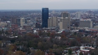 DX0001_003218 - 5.7K stock footage aerial video slowly flyby the city's skyline before flying away in Downtown Lexington, Kentucky