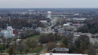 DX0001_003221 - 5.7K stock footage aerial video flyby busy street in industrial area near water tower in Lexington, Kentucky
