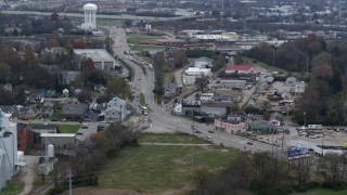 DX0001_003222 - 5.7K stock footage aerial video passing a busy street in industrial area near water tower in Lexington, Kentucky