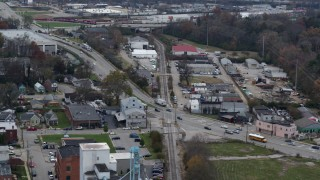 DX0001_003223 - 5.7K stock footage aerial video passing a busy street and railroad tracks in industrial area in Lexington, Kentucky