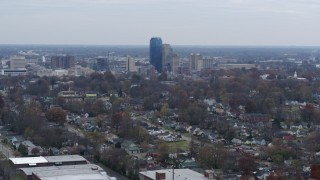 DX0001_003226 - 5.7K stock footage aerial video ascend from neighborhood and focus on city skyline, Downtown Lexington, Kentucky