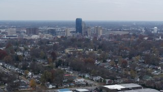 DX0001_003231 - 5.7K stock footage aerial video of city skyline while flying by tree-lined neighborhoods, Downtown Lexington, Kentucky