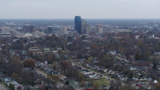 DX0001_003232 - 5.7K stock footage aerial video of city skyline while flying past tree-lined neighborhoods, Downtown Lexington, Kentucky