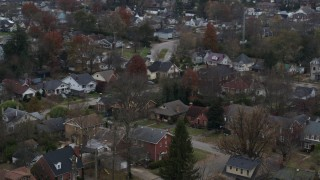 DX0001_003233 - 5.7K stock footage aerial video of panning across suburban homes and quiet streets in Lexington, Kentucky