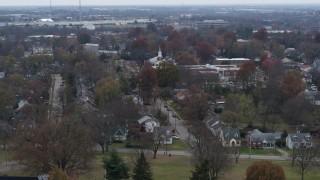 DX0001_003234 - 5.7K stock footage aerial video church steeple behind suburban neighborhood in Lexington, Kentucky