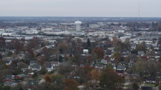 DX0001_003236 - 5.7K stock footage aerial video of a water tower surrounded by warehouse buildings in Lexington, Kentucky