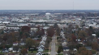 DX0001_003237 - 5.7K stock footage aerial video of a tall water tower surrounded by warehouse buildings in Lexington, Kentucky