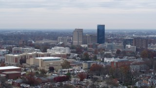 DX0001_003243 - 5.7K stock footage aerial video of flying by skyscrapers in the city skyline of Downtown Lexington, Kentucky