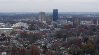 DX0001_003244 - 5.7K stock footage aerial video of flying by skyscrapers in the city skyline, seen from neighborhoods, Downtown Lexington, Kentucky