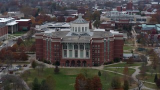 DX0001_003246 - 5.7K stock footage aerial video descend while focused on a University of Kentucky library, Lexington, Kentucky