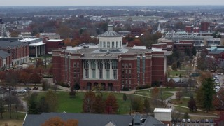 DX0001_003247 - 5.7K stock footage aerial video a reverse view of a University of Kentucky library, Lexington, Kentucky