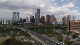 DX0002_102_003 - 5.7K stock footage aerial video ascend by First Street Bridge and Lady Bird Lake with view of skyline, Downtown Austin, Texas
