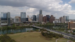 DX0002_102_005 - 5.7K stock footage aerial video of First Street Bridge and Lady Bird Lake with view of skyline, Downtown Austin, Texas
