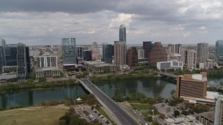 DX0002_102_006 - 5.7K stock footage aerial video of First Street Bridge spanning Lady Bird Lake with view of skyline, Downtown Austin, Texas
