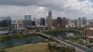 DX0002_102_008 - 5.7K stock footage aerial video of First Street Bridge and Lady Bird Lake with view of the city skyline, Downtown Austin, Texas