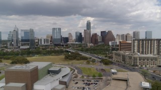 DX0002_102_010 - 5.7K stock footage aerial video approach First Street Bridge, Lady Bird Lake, and the city skyline, Downtown Austin, Texas
