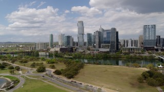 DX0002_102_014 - 5.7K stock footage aerial video of a view of city skyline across Lady Bird Lake during descent, Downtown Austin, Texas