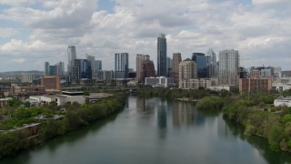 DX0002_102_015 - 5.7K stock footage aerial video of a view of the city skyline from Lady Bird Lake, Downtown Austin, Texas