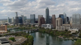 DX0002_102_018 - 5.7K stock footage aerial video approach the city skyline from Lady Bird Lake and ascend, Downtown Austin, Texas