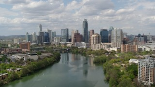 DX0002_102_021 - 5.7K stock footage aerial video fly toward the city skyline from Lady Bird Lake, Downtown Austin, Texas