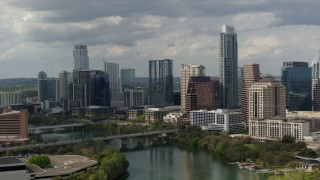 DX0002_103_008 - 5.7K stock footage aerial video reverse view of waterfront skyscrapers by Lady Bird Lake in Downtown Austin, Texas