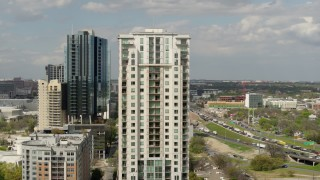 DX0002_103_009 - 5.7K stock footage aerial video of orbiting a high-rise apartment building in Downtown Austin, Texas