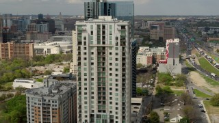 DX0002_103_011 - 5.7K stock footage aerial video of circling a high-rise apartment building in Downtown Austin, Texas